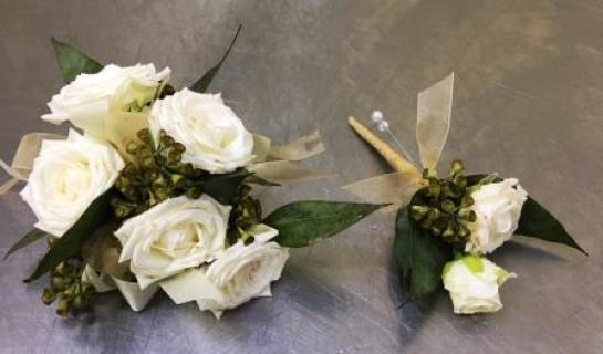 White Roses with seeded eucalyptus and gold ribbon