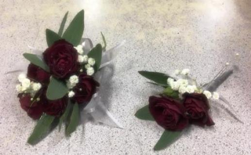 Red Roses Corsage and Boutonniere with eucalyptus and babies bre
